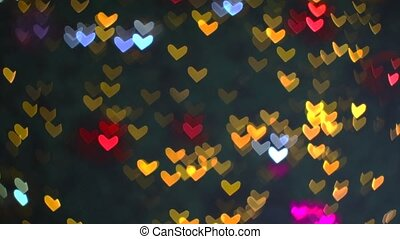 Blurred red blue orange warm shape hearts blink on tree beautiful  night light in the garden