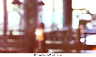 Blurred restaurant background for keying. Sunshine in a...