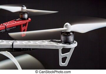 blurred rotors of a drone - rotating propellers of a...