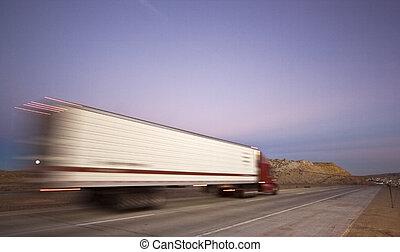 Blurred semi on the road - Wyoming.