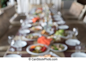 blurred served table, background