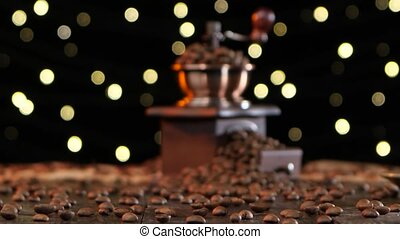 Blurred shooting. Coffee grinder and cup hot drink with...