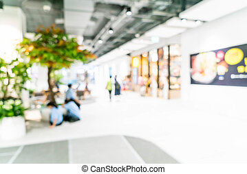 blurred shopping mall and retail store
