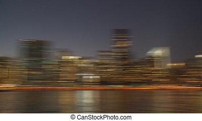 blurred skyline manhattan by night pan shot
