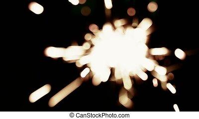 Blurred sparkler fire in dark