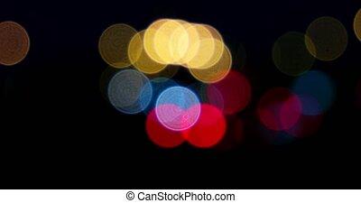 Blurred street lights in the night. Carlights defocused.