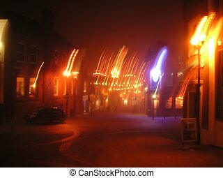 blurred street scene - blurred lit street scene