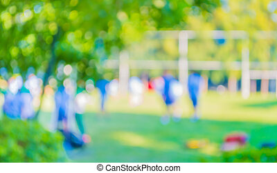 blurred student 's activity in soccer field at school on day time image