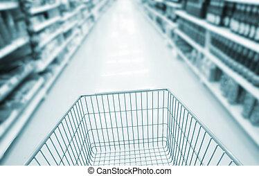 blurred supermarket cart