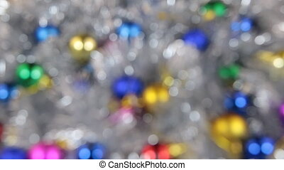 Blurred, the rotation of Christmas balls and silvery tinsel....