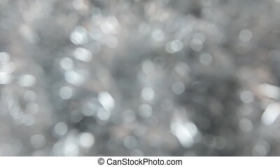 Blurred, the rotation of silver tinsel. Christmas and New...