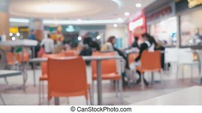 Blurred timelapse video of food court. Defocused or blurred...