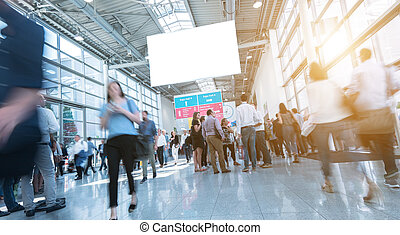 crowd of business people ruhsing in a trade show hall. ideal for websites and magazines layouts