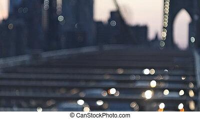 Blurred urban traffic Brooklyn Bridge at twilight in New York City background scene at night