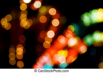 blurred varicoloured lights are in darkness of night