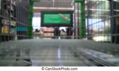 Blurred video. Shopping cart in supermarket retail
