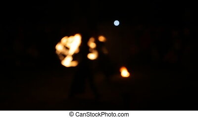 Blurred View, Fire Show. Men make fire circles. Blurry...