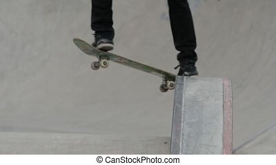 Blurred view of a young man jumping from the ledge in skate...