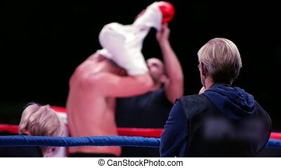 Blurred view of boxer on the ring. Slow motion