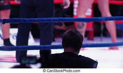Blurred view of boxers legs on the ring.