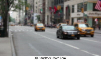 Blurred view of NYC with yellow cabs traffic - NYC with...