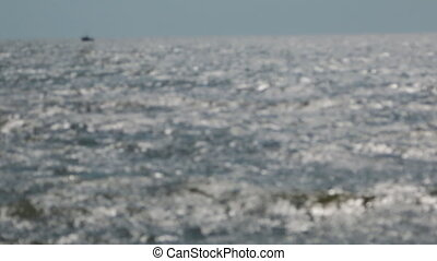 Blurred view of the sea waves and ship.