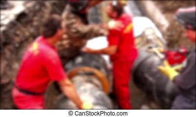 Blurred view on team of workers