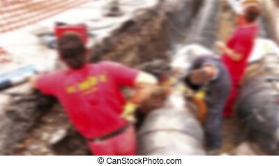 Blurred view on team of workers - Team of workers in trench...