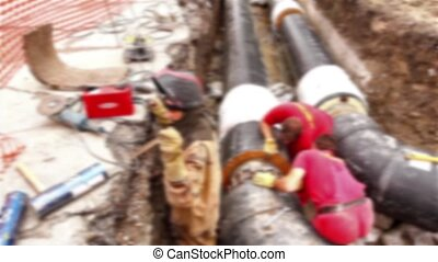 Blurred view on team of workers - Team of workers in trench ...