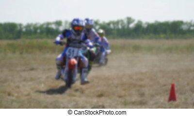 Enduro racer rides a motocross bike - Blurred view. Training...