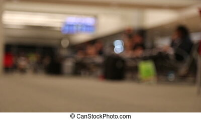 Blurred waiting hall in airport terminal