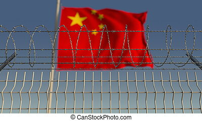 Blurred waving flag of China behind barbed wire fence. 3D rendering