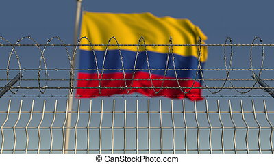 Blurred waving flag of Colombia behind barbed wire fence. 3D rendering
