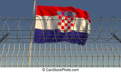 Blurred waving flag of Croatia behind barbed wire fence. 3D rendering