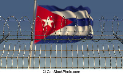 Blurred waving flag of Cuba behind barbed wire fence. 3D rendering