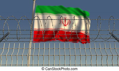 Blurred waving flag of Iran behind barbed wire fence. 3D rendering