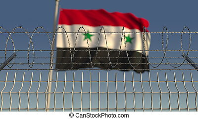 Blurred waving flag of Syria behind barbed wire fence. 3D rendering