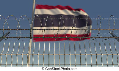 Blurred waving flag of Thailand behind barbed wire fence. 3D rendering
