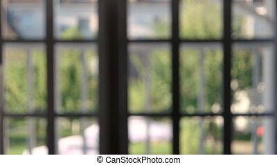 Blurred window frames indoor. Blurry summer nature.