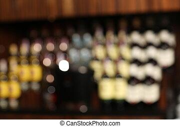 Blurred wine bottles background with luxury restaurant blur interior