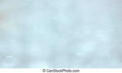 Blurred winter background with falling snow.