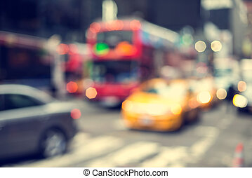 Blurry abstract photo of yellow taxi cabs in Times Square in Manhattan