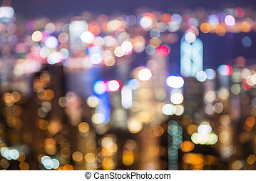 blurry and bokeh og big city in night time.