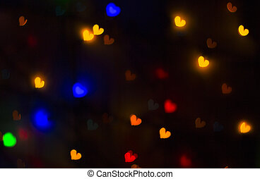 blurry bright background abstraction with coloured hearts