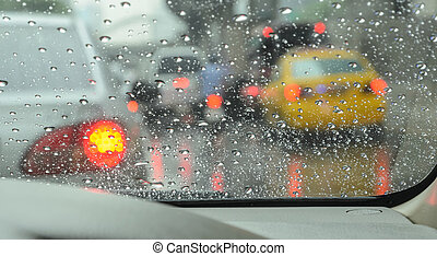 Blurry car on road in rainy day - Blurry car seen through ...