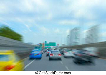 blurry cars on traffic the highway