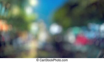Blurry Clip of Traffic on Asian Street with Bokeh Effect