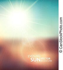 Blurry evening scene with brown field, sun burst