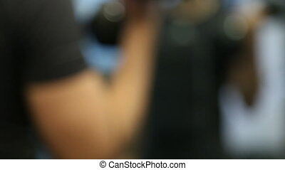Blurry figure lifting weights - Shot of Blurry figure...