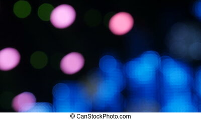 Blurry focus of colorful ray light in the background of stage